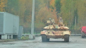T-90 tanks in motion. Russia. Nizhniy Tagil, Russia - September 25. 2013: T-90 tanks move to shooting demonstration range. RAE-2013 exhibition. Russian Arms Expo stock video footage