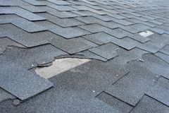 stock image of  Ð¡lose up view of asphalt shingles roof damage that needs repair.