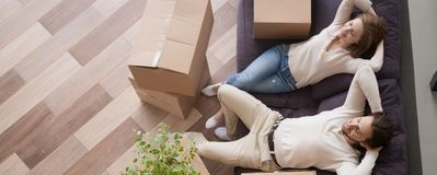 stock image of  above view married couple resting on couch at moving day