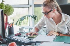 stock image of  accountant making a financial report. finances and economy concept.