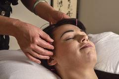 stock image of  accupuncture head and temples  chinese medicine