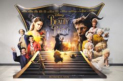 stock image of  an advertisement display stand of the movie beauty and the beast