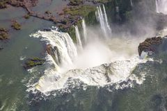 stock image of  aerial bird`s-eye view of beautiful rainbow above iguazu falls devil`s throat chasm from a helicopter flight. south america.