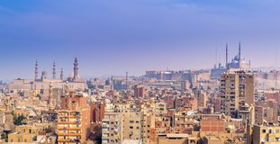 stock image of  aerial cityscape view of old cairo, egypt with cairo citadel and sultan hasan mosque in far distance