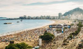 stock image of  aerial view of a crowded pre-nye party copacabana beach in rio de janeiro, brazil. the beach is 4km long and is one of