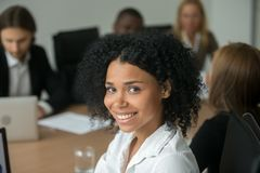 stock image of  african american attractive businesswoman at team meeting, head