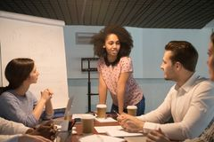 stock image of  african american young project manager coach speaking at team meeting