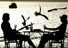 stock image of  couple having a meal by the sea