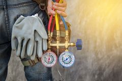 stock image of  air conditioning technician and a part of preparing to install n