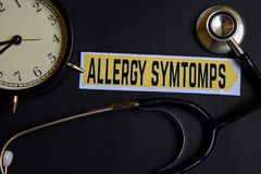 stock image of  allergy symtomps on the paper with healthcare concept inspiration. alarm clock, black stethoscope.