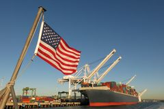 stock image of  american flag us port container ship symbols economy industry pride