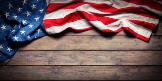 stock image of  american flag on wooden table