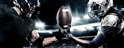 stock image of  two american football sportsman players on stadium. sport concept.