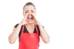 stock image of  angry hypermarket seller screaming