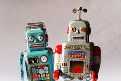 stock image of  angry vintage tin toy robots, artificial intelligence, robotic delivery concept