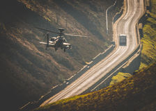 stock image of  apache helicopter flying