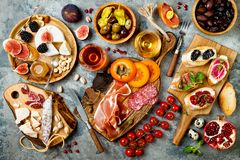 stock image of  appetizers table with italian antipasti snacks and wine in glasses. brushetta or authentic traditional spanish tapas set