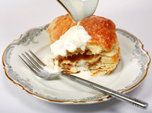 stock image of  apple turnover and cream