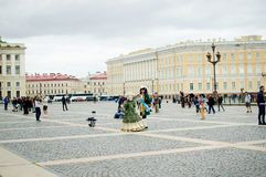 stock image of  artists in ancient costumes entertain tourists on the palace square in st. petersburg