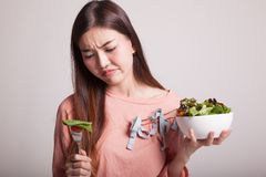 stock image of  asian woman hate salad.