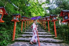 stock image of  asian woman wearing japanese traditional kimono at kifune shrine in kyoto, japan