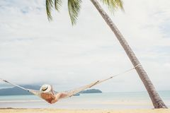 stock image of  asian women relaxing in hammock summer holiday on beach