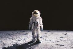 stock image of  astronaut walking on the moon