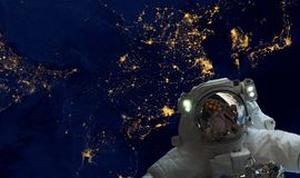stock image of  astrounaut spacewalk in the space on earth orbit at night. elements of this image furnished by nasa f