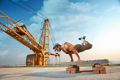 stock image of  athletic man doing exercise push ups on hands.