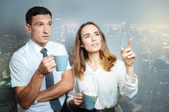 stock image of  attentive coworkers looking away with interest