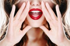 stock image of  attractive young woman lady model girl telling a secret
