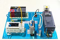 stock image of  automatic inverter electric current vector-vfd connect with program logic controller plc & switching hub wireless modem for
