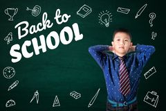 stock image of  back to school text with asian kid and stationery supplies school object activities for learning, hand drawn on the green