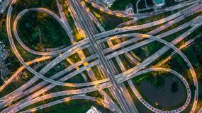 stock image of  bangkok expressway top view, top view over the highway,expressway and motorway at night, aerial view interchange of a city, shot