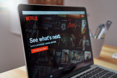stock image of  bangkok, thailand - august 23, 2017 : netflix app on laptop screen. netflix is an international leading subscription service for w