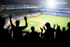 stock image of  baseball fans and crowd cheering in stadium.