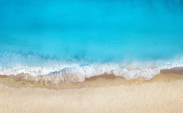 stock image of  beach and waves from top view. turquoise water background from top view. summer seascape from air.