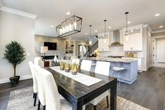 stock image of  beautiful kitchen in luxury modern contemporary home interior with island and chairs