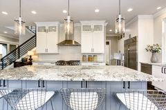 stock image of  beautiful kitchen in luxury modern home interior with island
