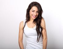 stock image of  beautiful positive woman in white shirt and long hair toothy smi