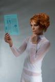 stock image of  beautiful woman hold e hi-tech newspaper
