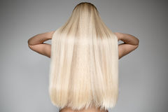stock image of  beautiful young blond woman with long straight hair