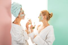 stock image of  beauty begins from inside. spa and wellness. girls friends sisters making clay facial mask. anti age mask. stay