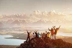 stock image of  big group of people success mountain top