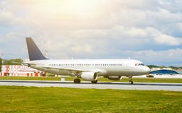 stock image of  big silver passenger jet plane on runway at airport a sunny day