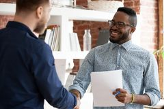 stock image of  black executive manager greeting company client starting business meeting