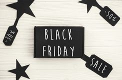 stock image of  black friday big sale text on price tag sign, minimalistic flat