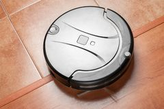 stock image of  black robotic vacuum cleaner, modern smart appliance, perfect automated floor cleaning tool to help automate housekeeping