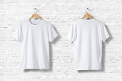 stock image of  blank white t-shirts mock-up hanging on white wall, rear and front side view.
