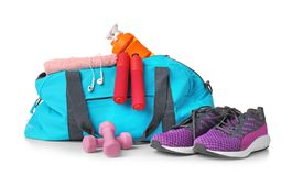 stock image of  sports bag and gym equipment on white background